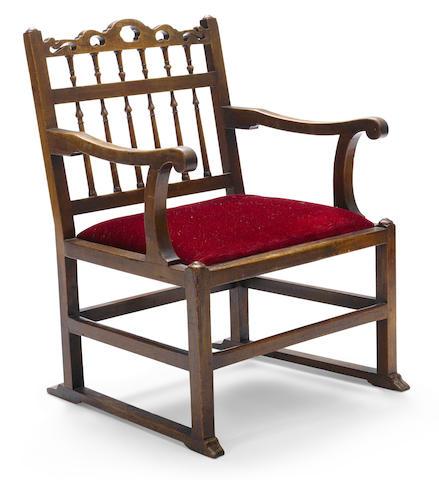 An unusual George III fruitwood armchair