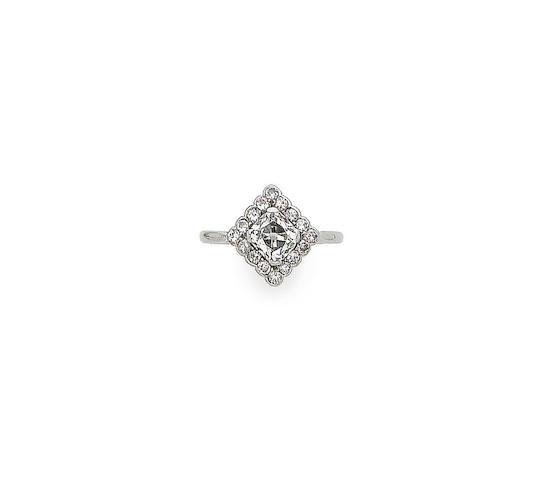 A diamond cluster dress ring