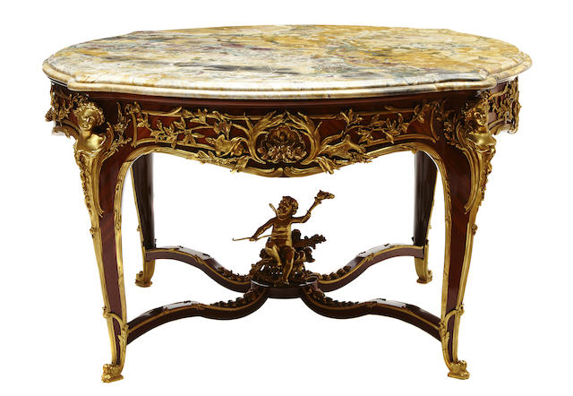 An impressive Louis XV style gilt bronze mounted center table