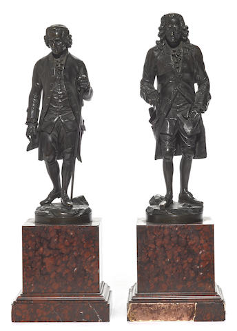 A pair of French patinated bronze figures of Voltaire and Rousseau