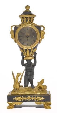 An Austrian gilt, patinated bronze and ebonized quarter chiming mantel clock