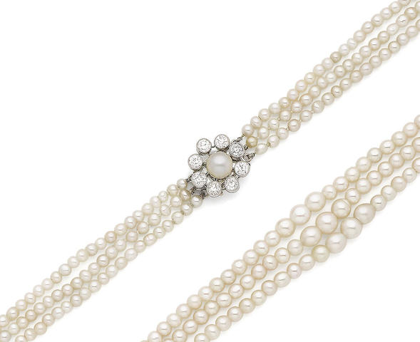 A three-row pearl necklace with a diamond clasp