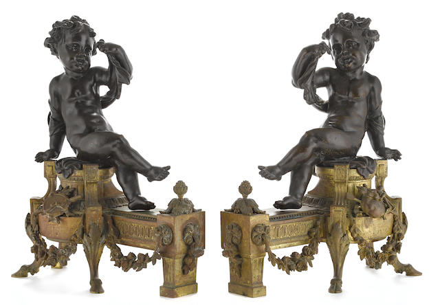 A pair of Louis XVI style gilt and patinated bronze figural chenets