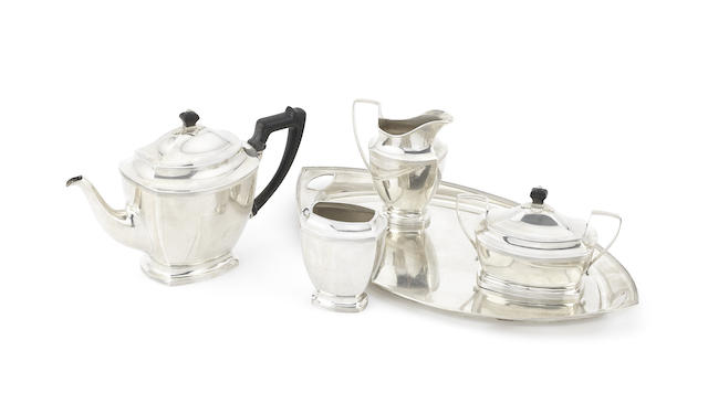 A 19th century Dutch silver four-piece tea service together with a matched tray