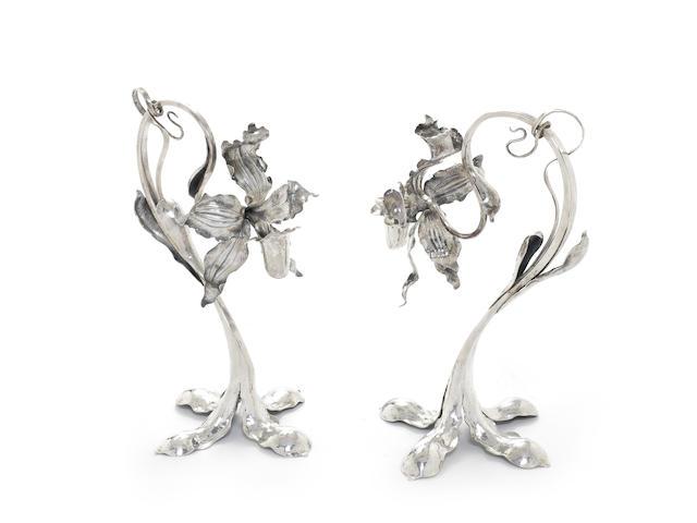 A pair of Dutch silver flower candlesticks