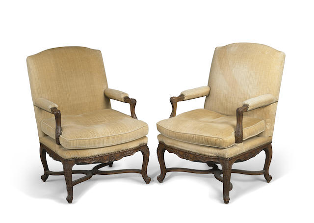 A pair of Régence style carved beechwood fauteuils