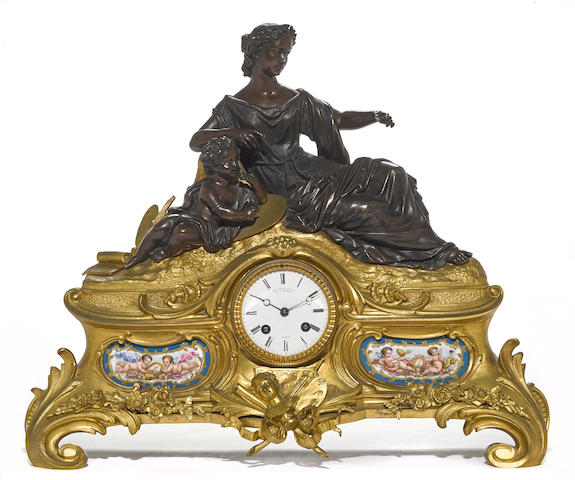 A Napoleon III gilt, patinated bronze and porcelain inset figural mantel clock