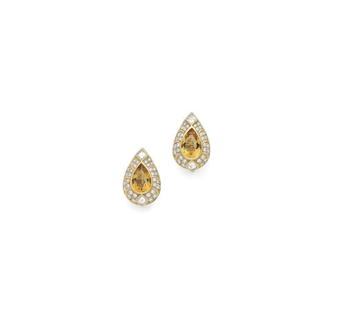 A pair of citrine and diamond earclips
