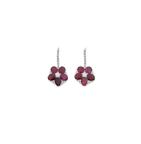 A pair of pink tourmaline and diamond flower earrings