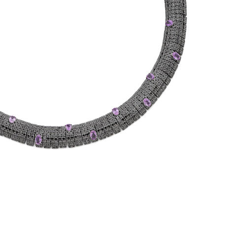 A pink sapphire and black diamond necklace