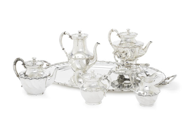 A five-piece Mexican silver tea service with a matched tray