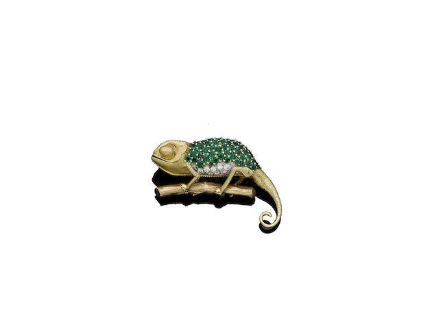 An emerald and diamond chameleon brooch
