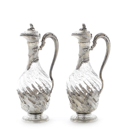 A pair of 19th century French silver mounted glass jugs