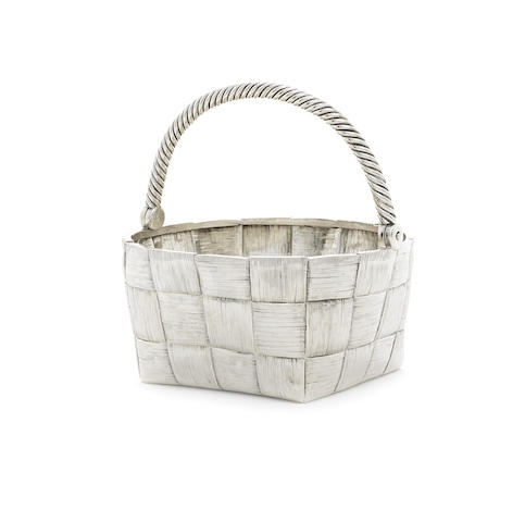 A late 19th century Russian silver trompe l'oeil swing handled basket