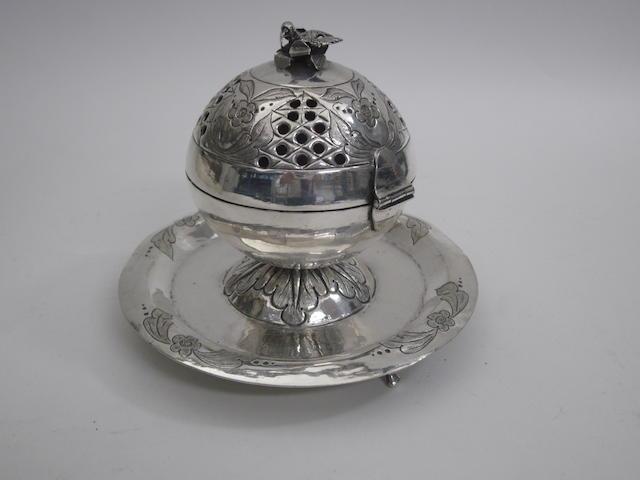 A Middle Eastern white metal incense burner