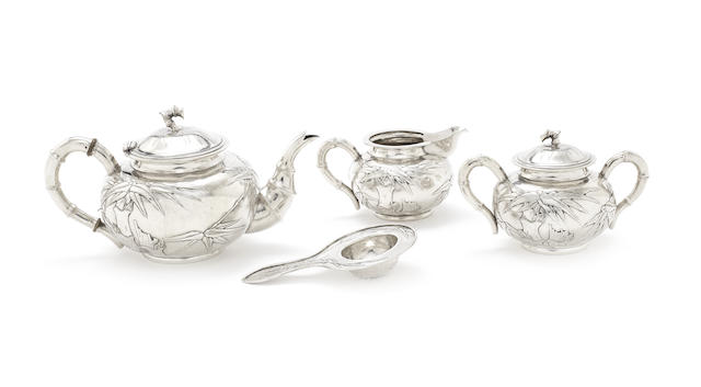 A Chinese Export three-piece silver tea service and strainer
