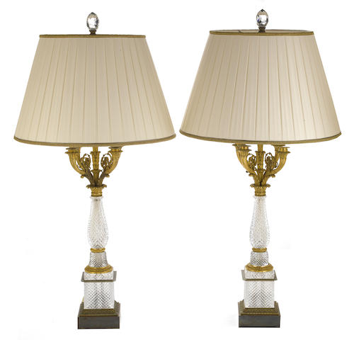 A pair of Charles X style gilt bronze and cut glass five light candelabra