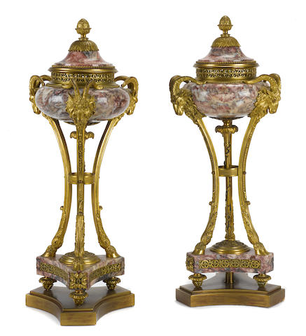 A pair of French gilt bronze mounted marble potpourri urns