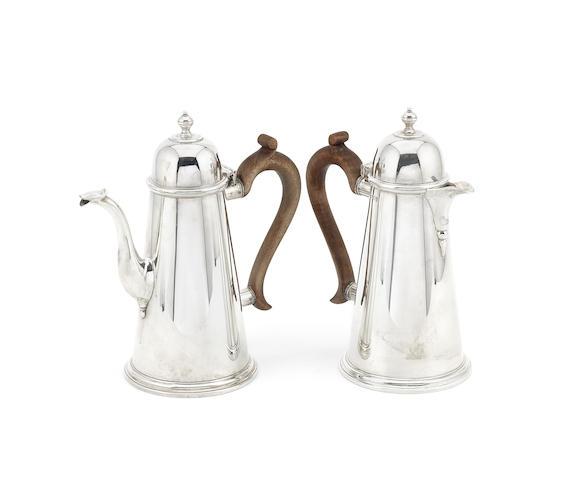 A pair of silver café au lait pots