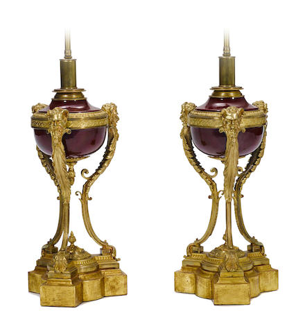 A pair of Louis XVI style gilt bronze and porcelain urns