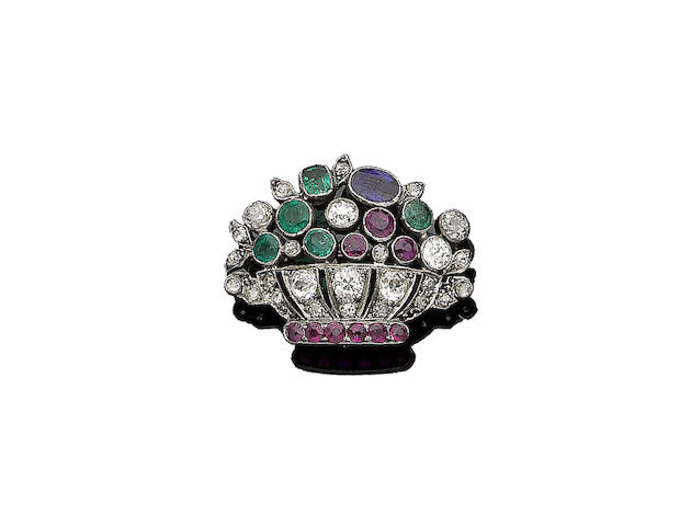 An emerald, ruby, sapphire and diamond brooch