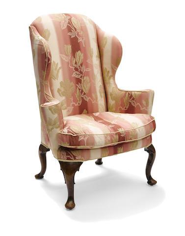 A George II walnut wing armchair