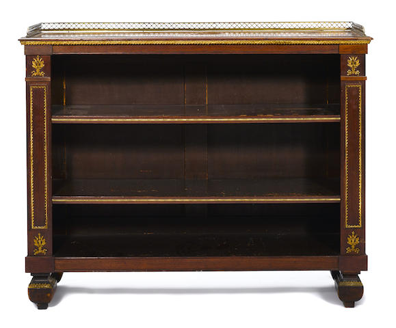 An Empire gilt metal mounted kingwood low open bookcase