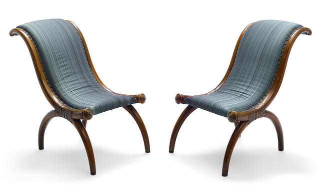 A pair of Continental Neoclassical carved fruitwood side chairs