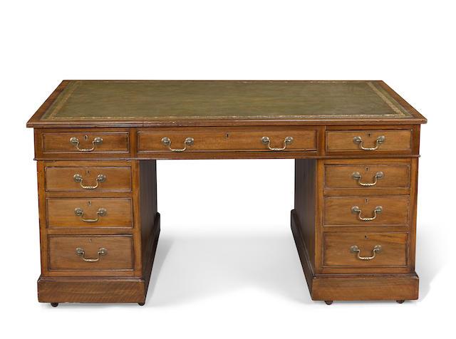 A George III style mahogany pedestal partners' desk