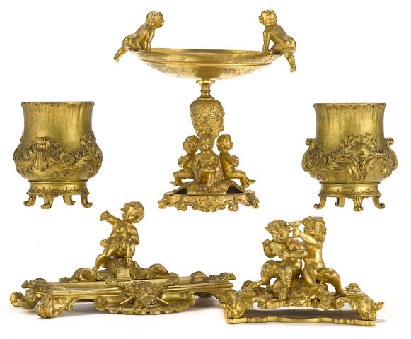 Five gilt bronze table accessories