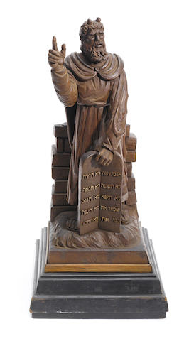 A Continental carved walnut figure of Moses