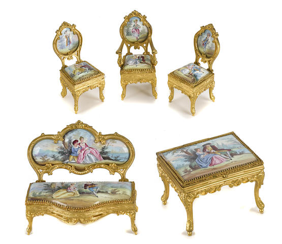 A Continental gilt metal and enamel suite of miniature furniture
