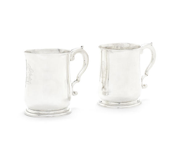 A matched pair of George II silver mugs