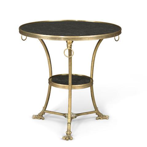 A Louis XVI style gilt bronze and granite guéridon