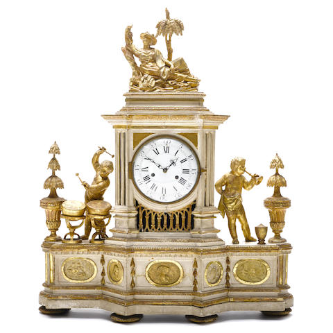 An imposing Italian Neoclassical parcel gilt and paint decorated mantel clock