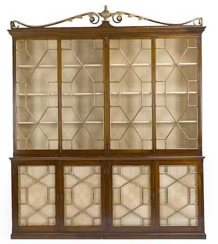 A large George III parcel gilt mahogany display cabinet