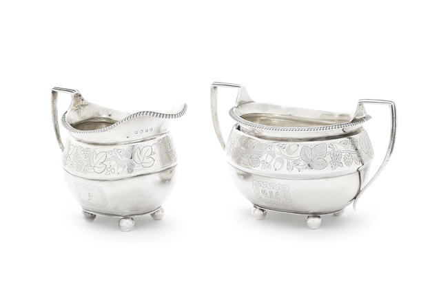 A George III silver cream jug and later matched sugar bowl