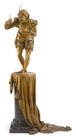 An Italian carved walnut figure of Rigoletto on pedestal
