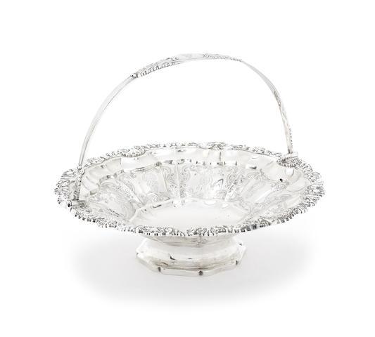 A George IV silver swing-handled basket