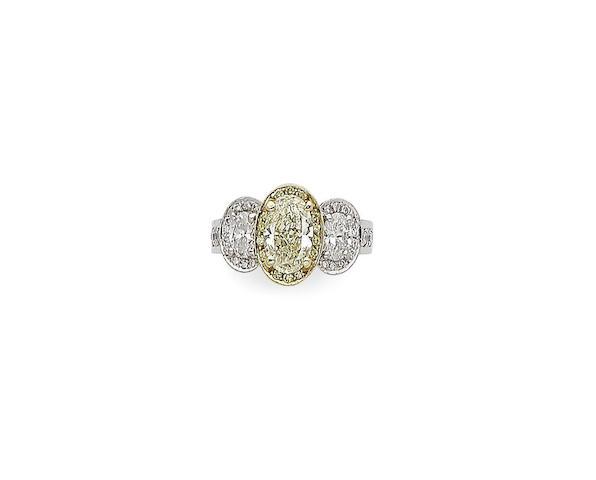 A fancy coloured diamond and diamond three-stone ring