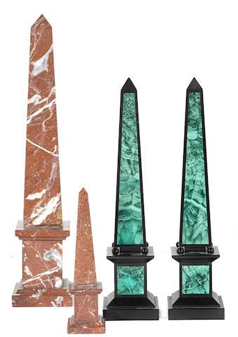 Four stone obelisks