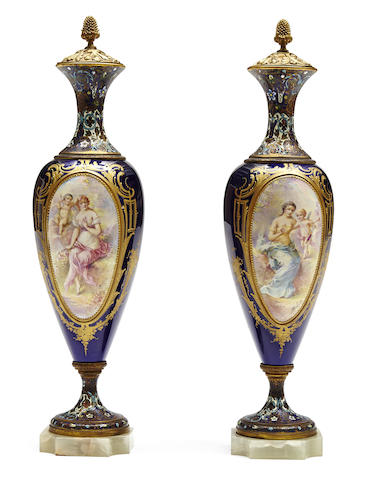 A pair of French champlevé and onyx mounted covered urns