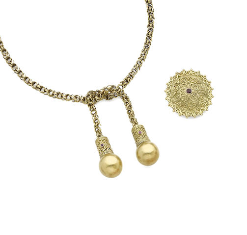 A gem-set necklace, brooch and pair of earrings