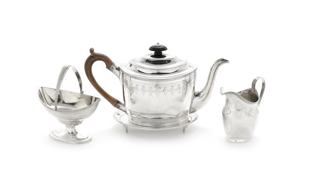 A George III silver three-piece tea service with teapot stand