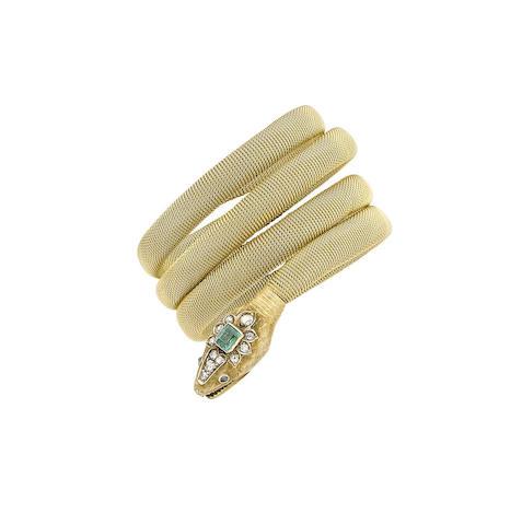 An emerald and diamond snake bangle