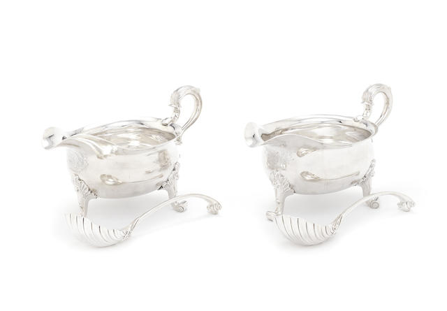 A pair of George II silver sauce boats and ladles