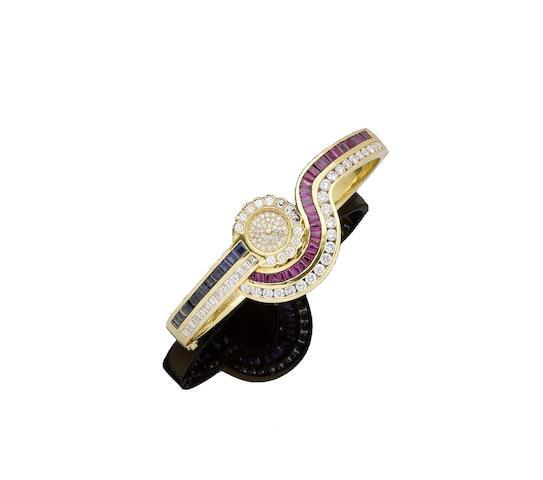 A ruby, sapphire and diamond bracelet watch