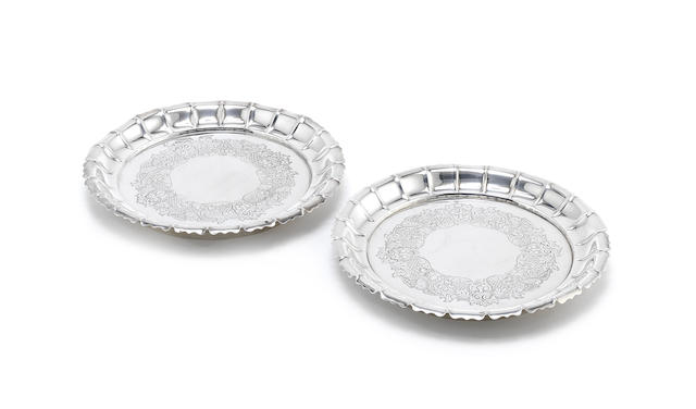 A pair of cased Victorian silver dishes