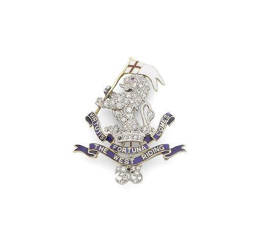 An enamel and diamond regimental brooch