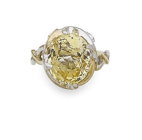 A yellow sapphire single-stone ring